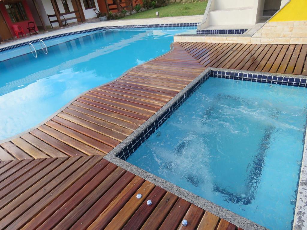 The swimming pool at or near Fazenda Jorge Tardin