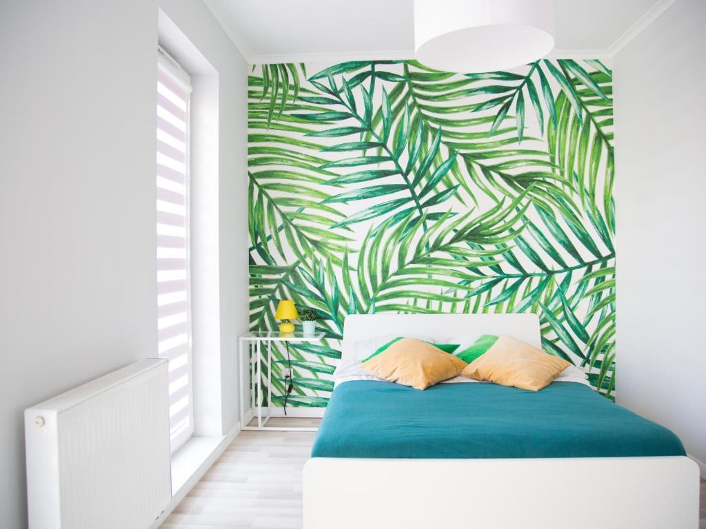 Łóżko lub łóżka w pokoju w obiekcie A.S. HOME Kosciuszki