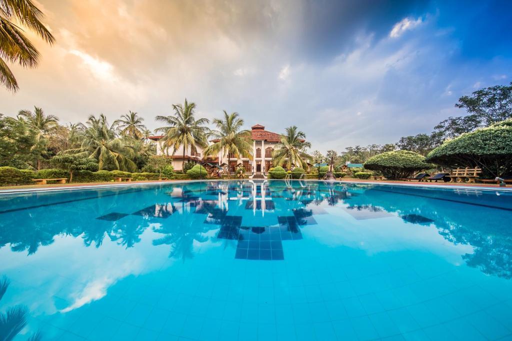 Der Swimmingpool an oder in der Nähe von Hotel Yapahuwa Paradise