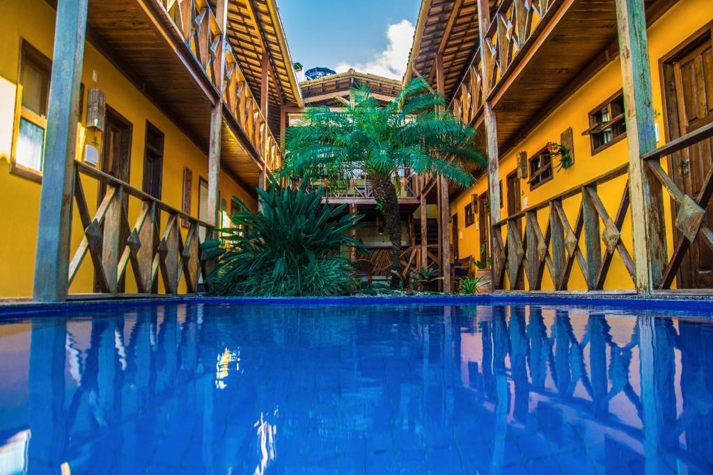 The swimming pool at or near Pousada Pérola Do Morro