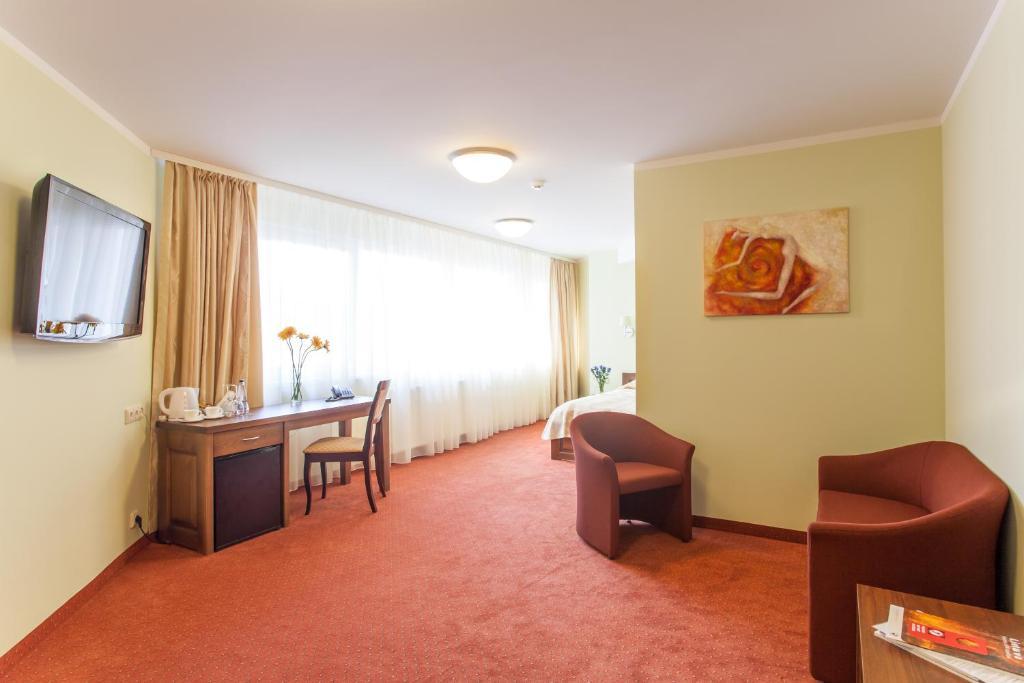 A seating area at AirInn Vilnius Hotel