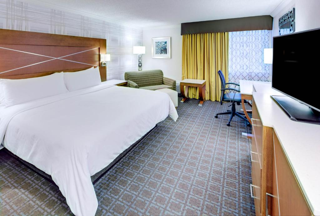 A bed or beds in a room at DoubleTree by Hilton Madison Downtown