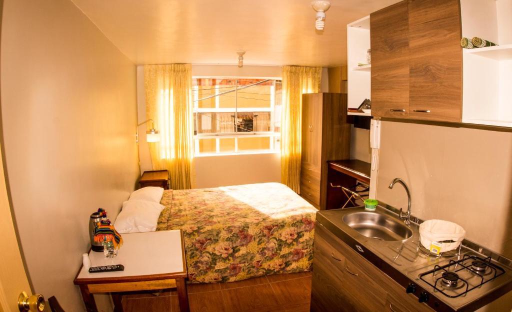 Una cocina o zona de cocina en Alojamiento Condor Kanqui