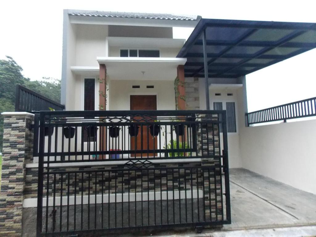 A balcony or terrace at Homestay Elysian
