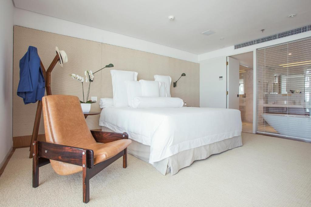 A bed or beds in a room at Emiliano Rio