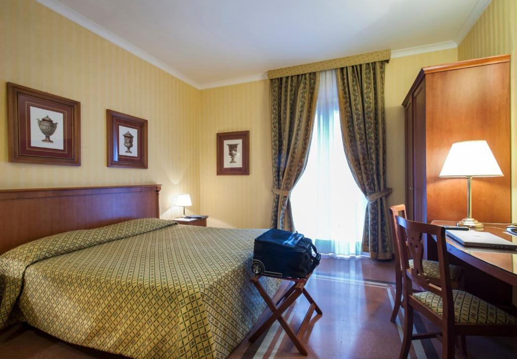 Ein Bett oder Betten in einem Zimmer der Unterkunft Residenza d'Aragona