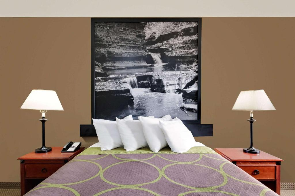 A bed or beds in a room at Super 8 by Wyndham Ithaca
