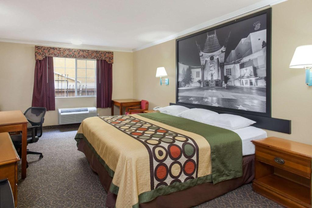 A bed or beds in a room at Super 8 by Wyndham Los Angeles Downtown