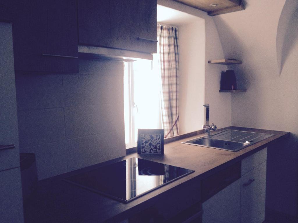 A kitchen or kitchenette at Gästehaus Rübezahl