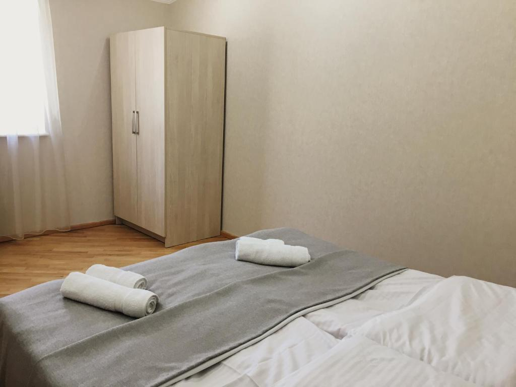 A bed or beds in a room at borjomi 77