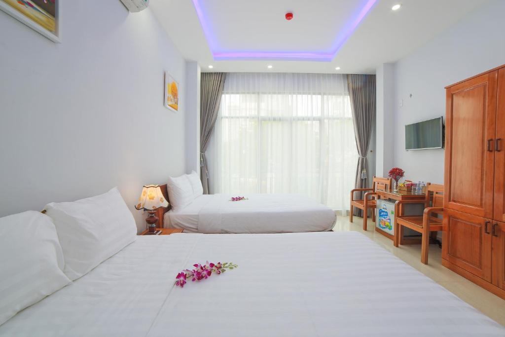 Кровать или кровати в номере Summer Beach