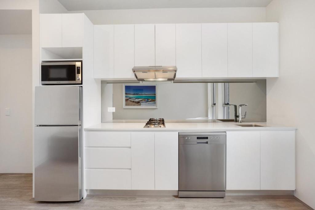 A kitchen or kitchenette at Bondi Beach Studios Suite 1