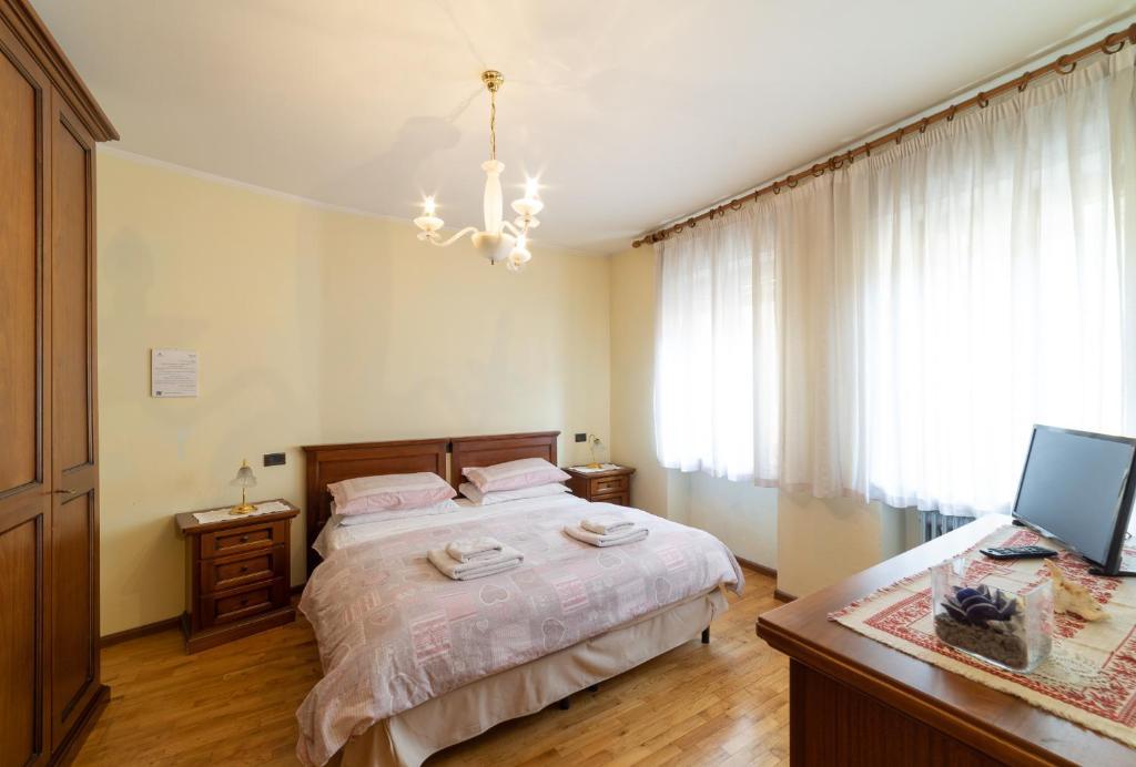 Ein Bett oder Betten in einem Zimmer der Unterkunft La Casa Di Fernanda