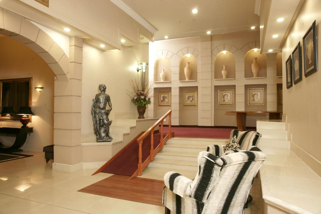 The lobby or reception area at Apollo Hotel