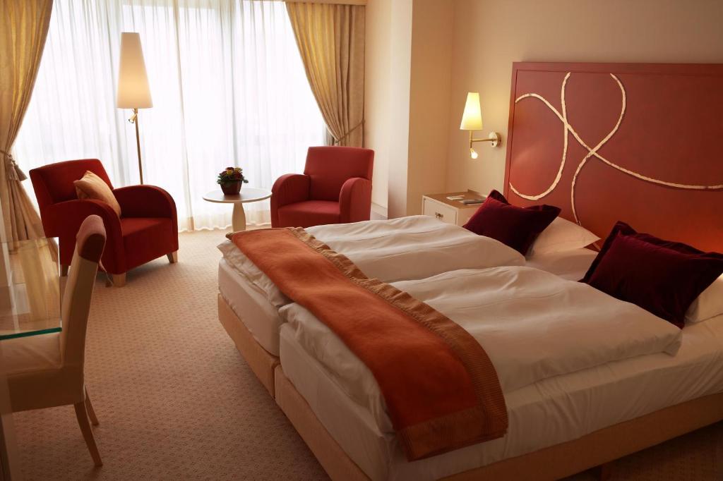 Un ou plusieurs lits dans un hébergement de l'établissement Casino 2000-adults only