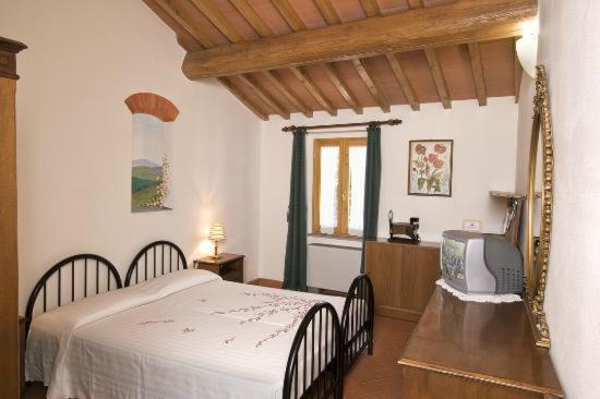 Casa di Zarino tesisinde bir odada yatak veya yataklar