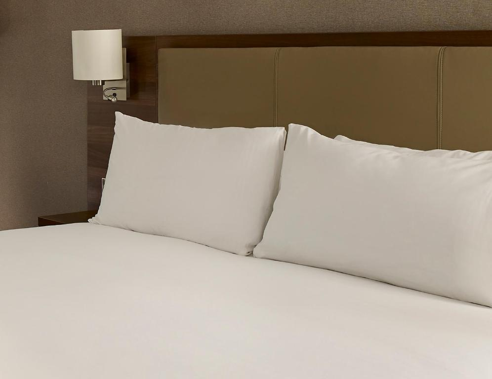 A bed or beds in a room at Jurys Inn Glasgow