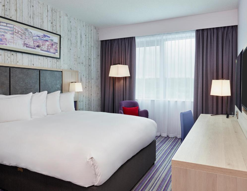 A bed or beds in a room at Jurys Inn Sheffield