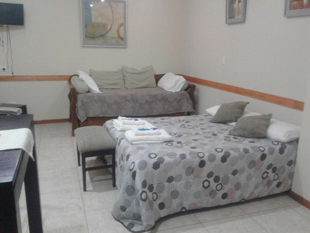 Una cama o camas en una habitación de Apart Hotel Savona