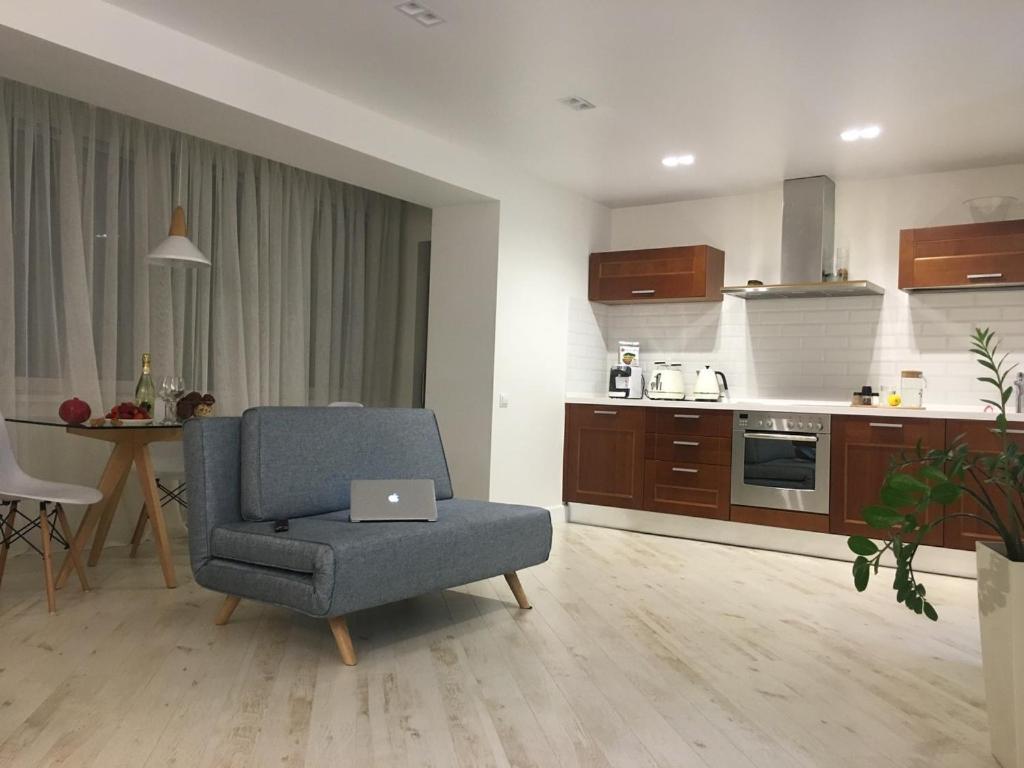 A kitchen or kitchenette at Apartment on Okeanskiy Prospekt