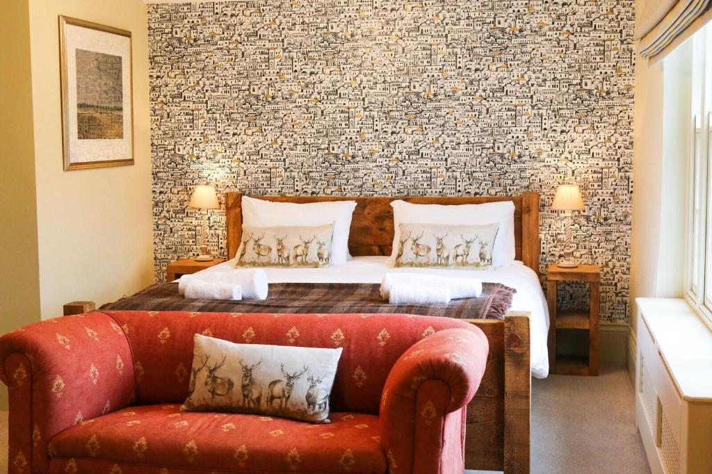 A bed or beds in a room at The Quay Bed & Breakfast