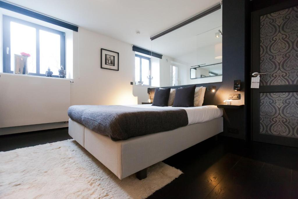 A bed or beds in a room at B&B Ad Astra