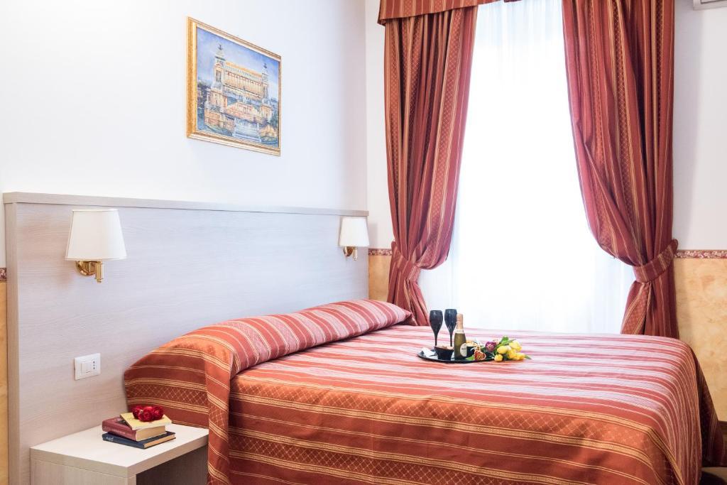 Ein Bett oder Betten in einem Zimmer der Unterkunft Domus Giulia