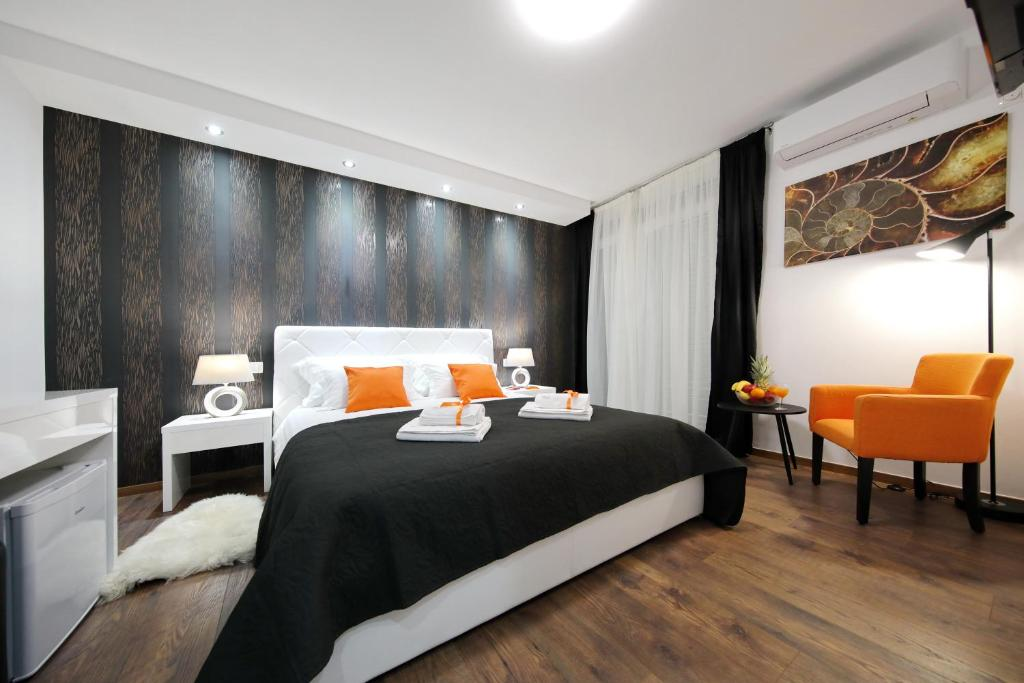 A bed or beds in a room at Zadar Luxury Rooms