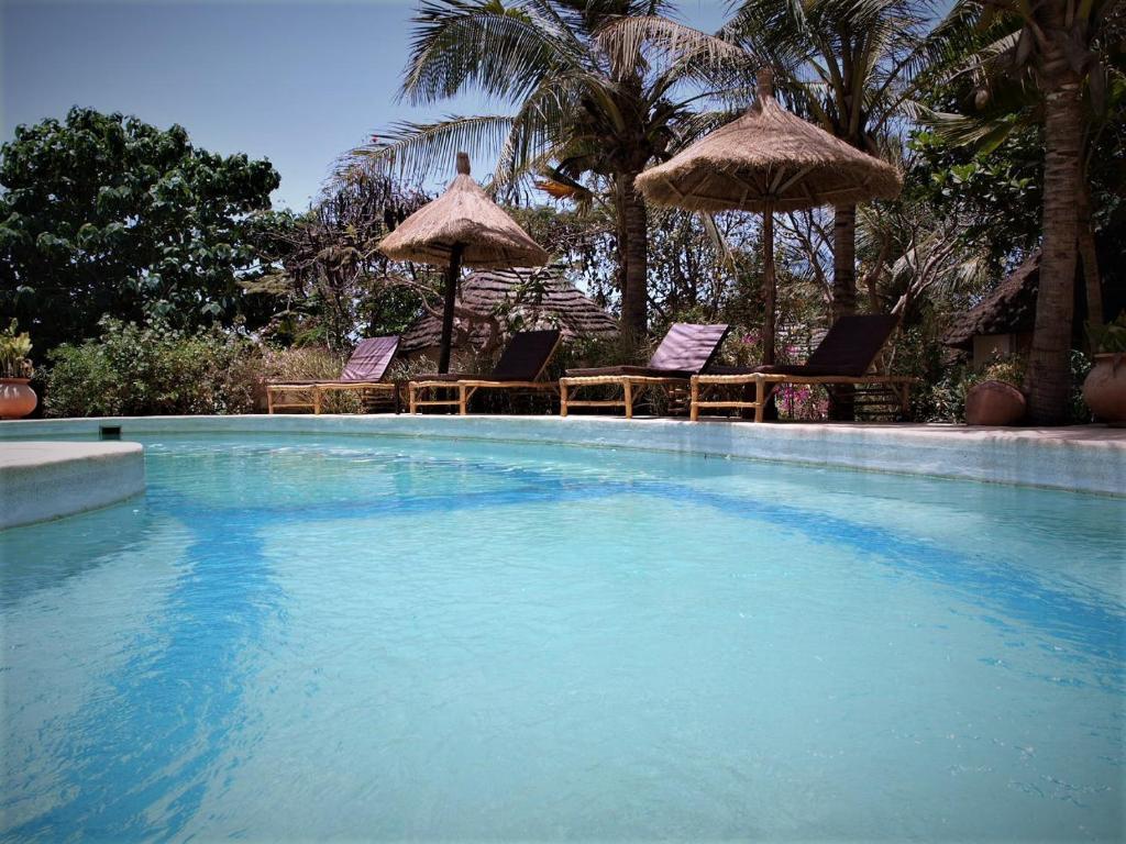 The swimming pool at or near Auberge Keurmariguen
