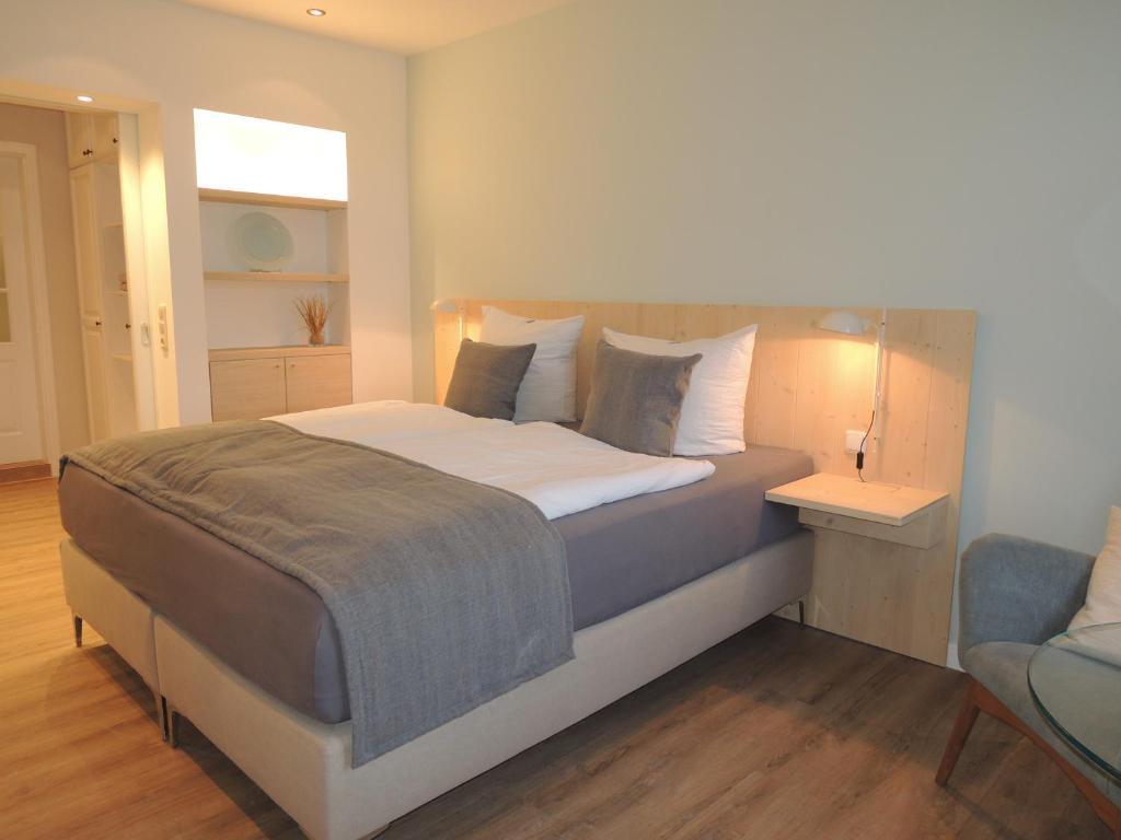 Ein Bett oder Betten in einem Zimmer der Unterkunft Gästehaus Muhl