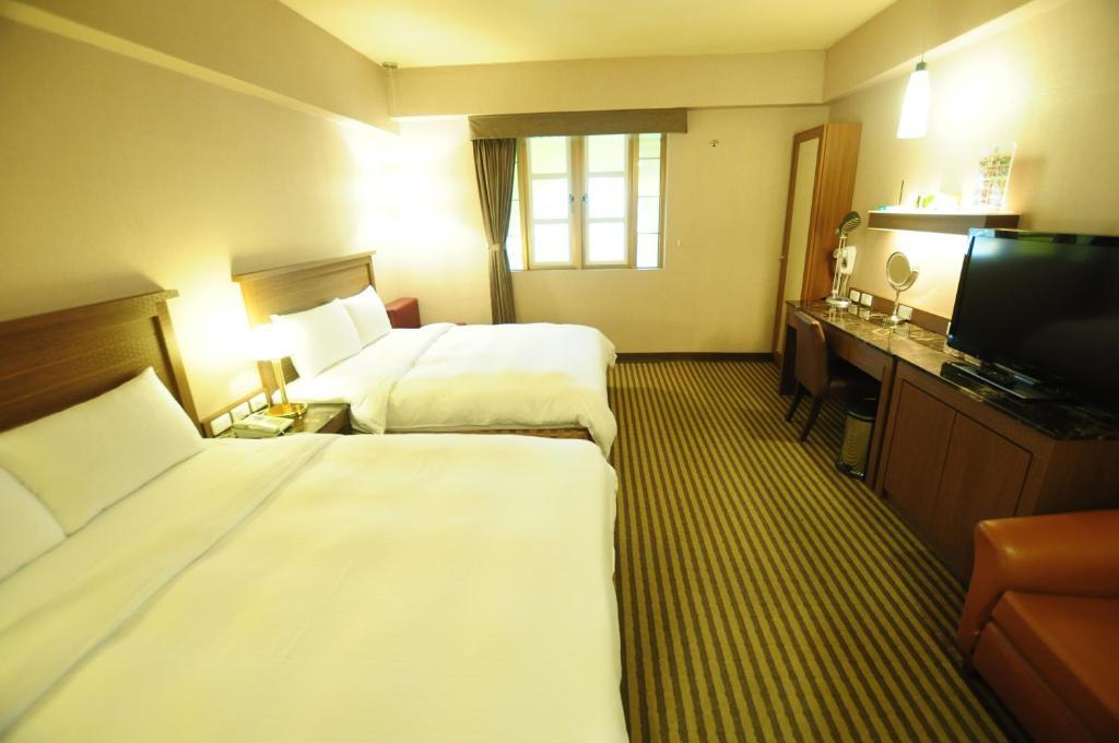 康橋大飯店台東館房間的床