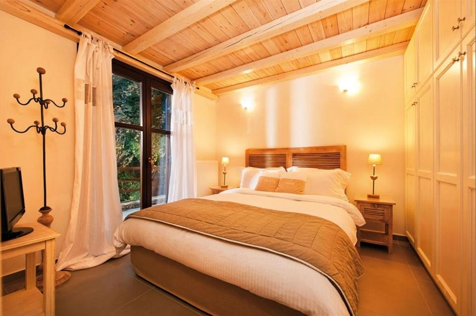 A bed or beds in a room at Vergopoulos Oliveyard