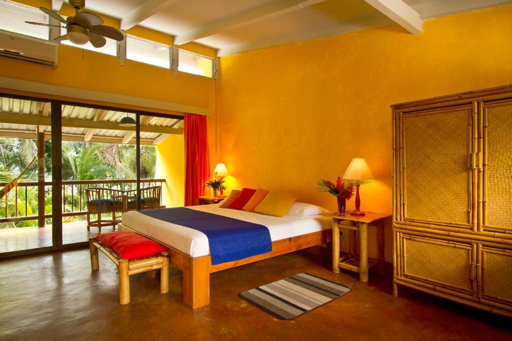 Cama o camas de una habitación en Villas del Caribe