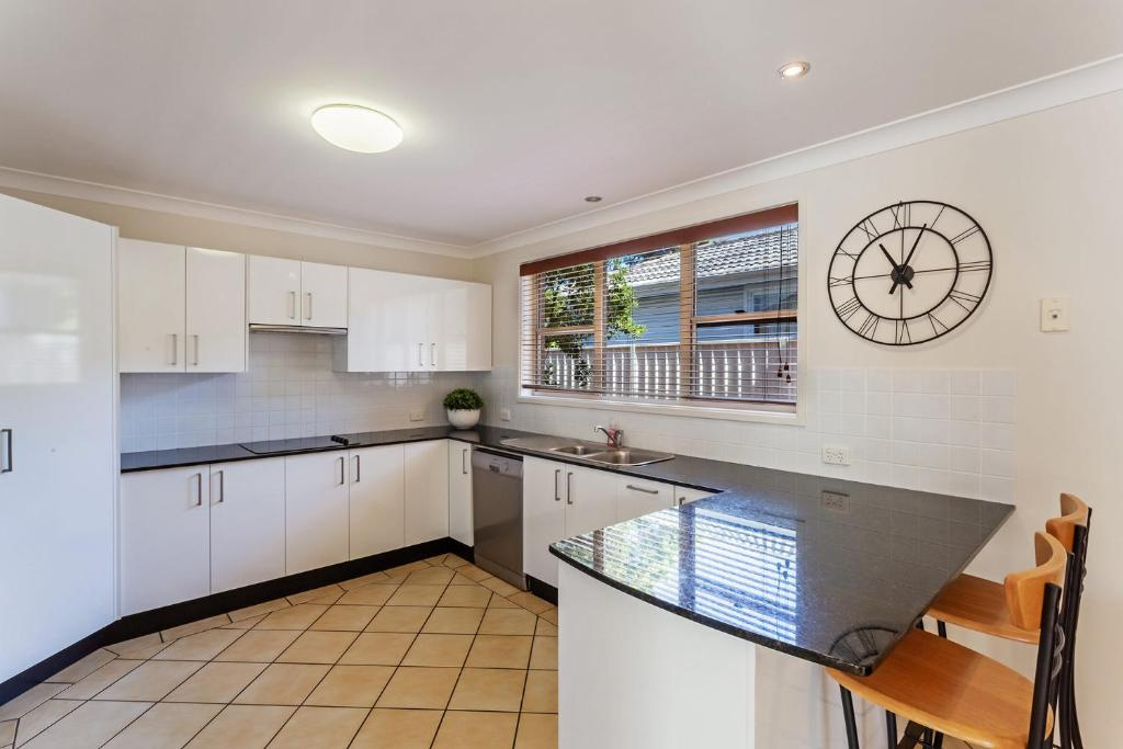 A kitchen or kitchenette at Spacious, Modern & Walk to the Beach!
