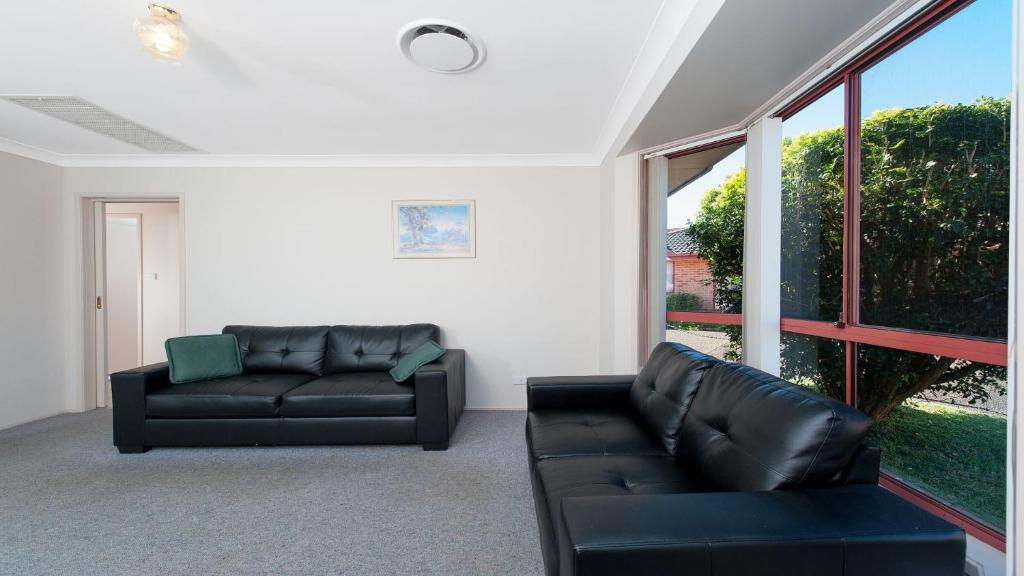 A seating area at Peaceful, Quiet and so close to the beach!