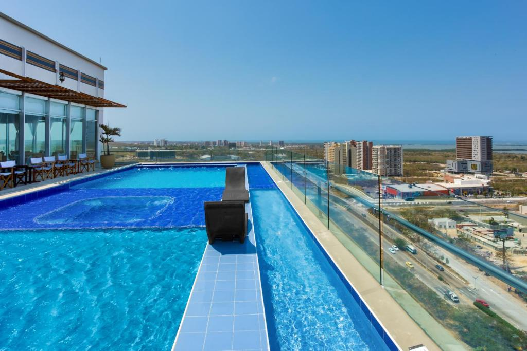 The swimming pool at or near GHL Collection Barranquilla Hotel
