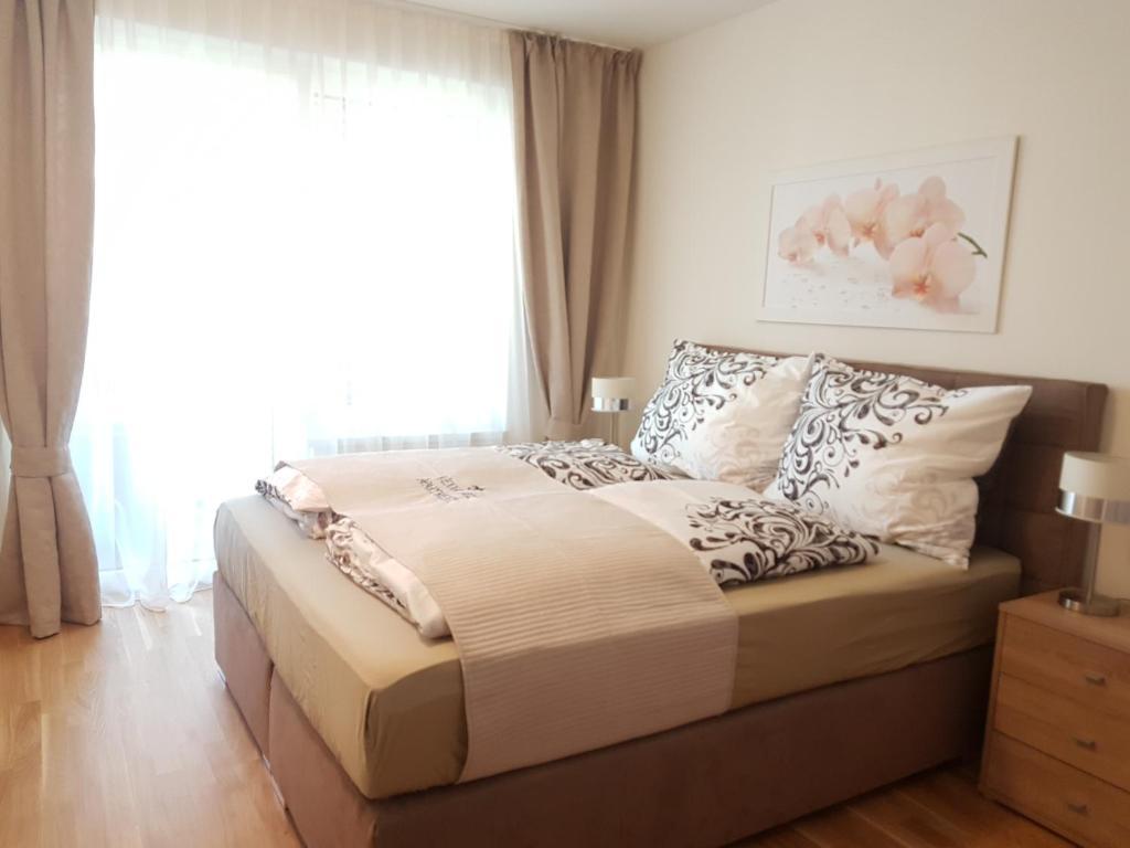 Postel nebo postele na pokoji v ubytování Vienna Nice Apartment