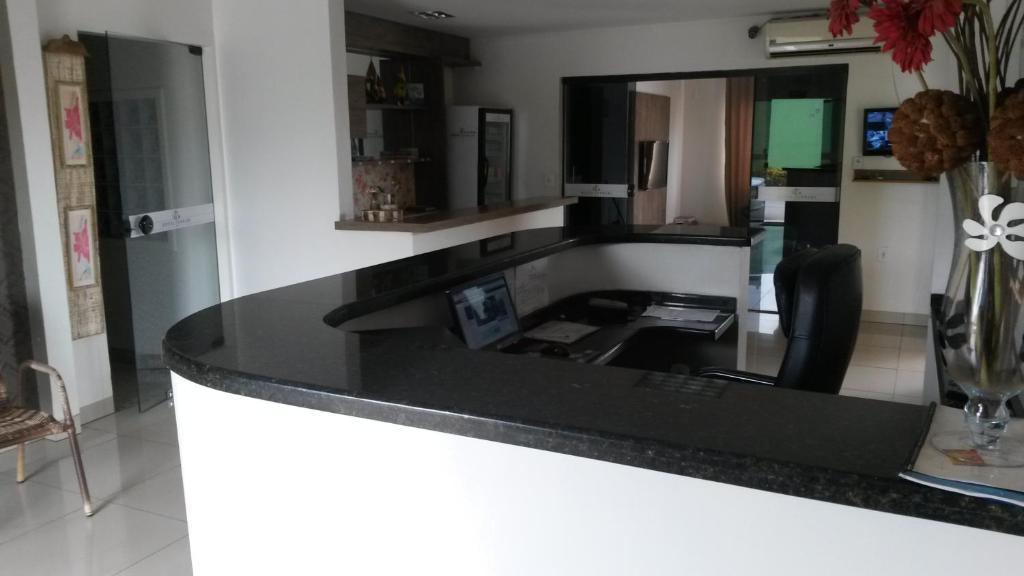 A kitchen or kitchenette at Hotel Ferrari