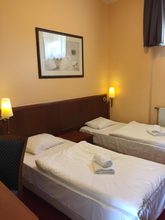 Łóżko lub łóżka w pokoju w obiekcie Diamond Premium Rumia