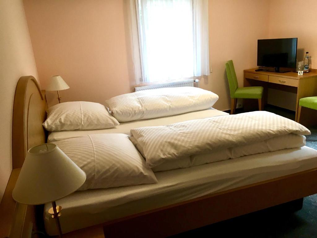 Ein Bett oder Betten in einem Zimmer der Unterkunft Schlößlesmühle