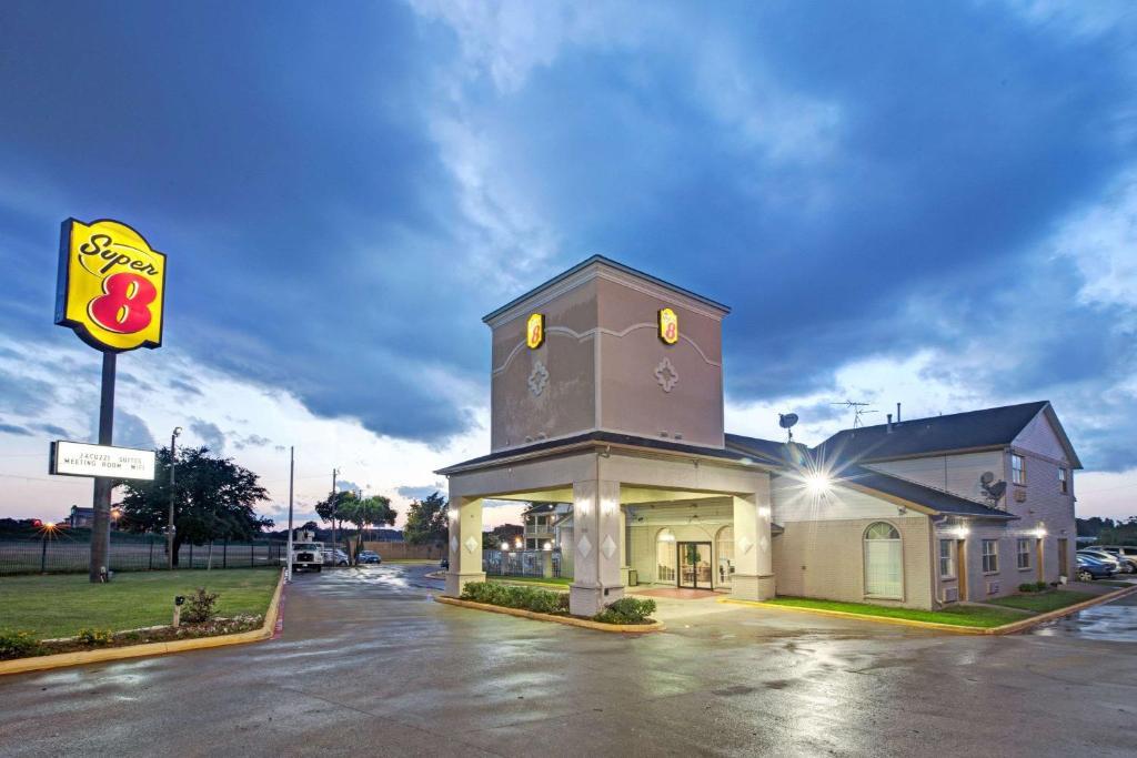 Super 8 by Wyndham Dallas East.
