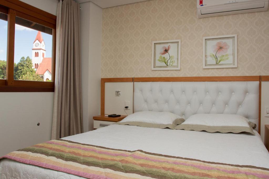 Cama ou camas em um quarto em Ótima Localização e Vista da Cidade