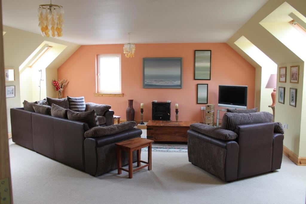 A seating area at Muir Park Holiday Home