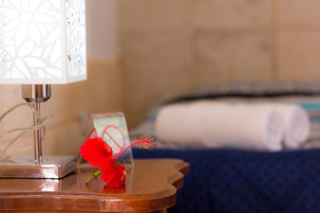 A bed or beds in a room at Hostal V&B