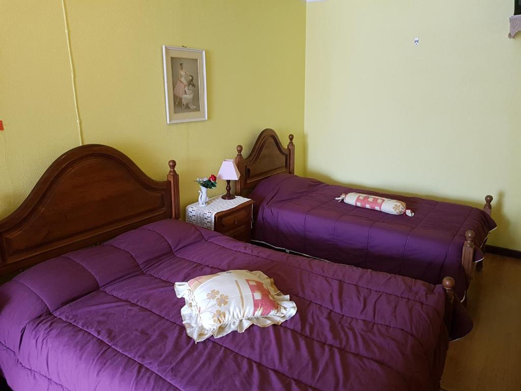 A bed or beds in a room at Residencial Bem Estar