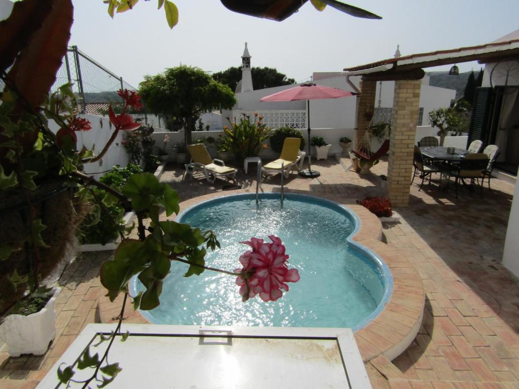 The swimming pool at or near Villa Tibouchina