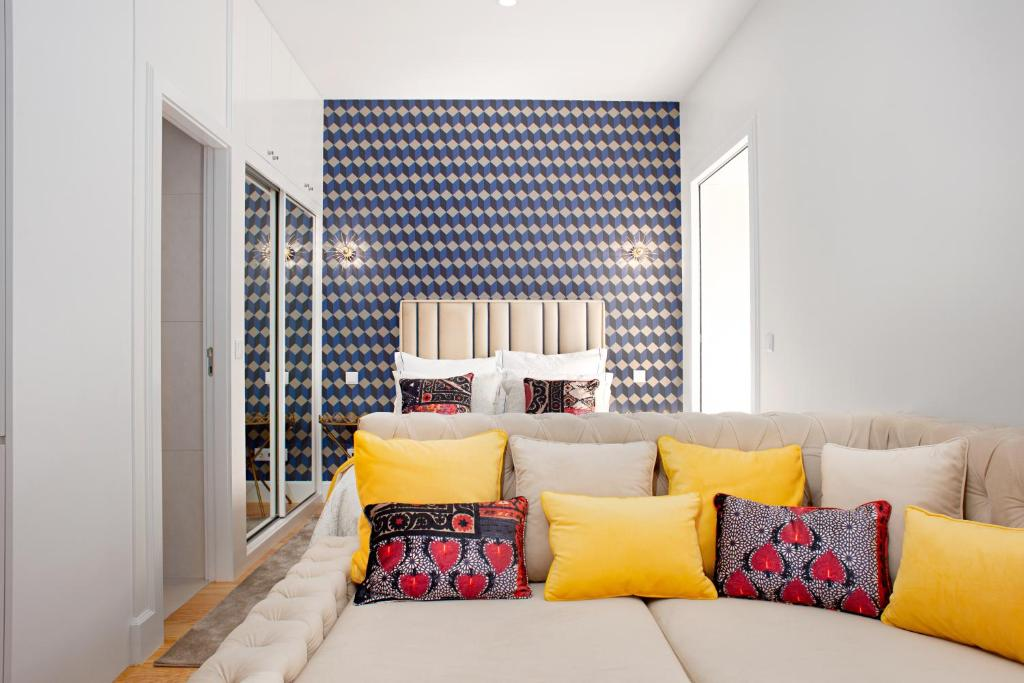 A bed or beds in a room at EXKLUSIVE Bandeira 1018 Apartments
