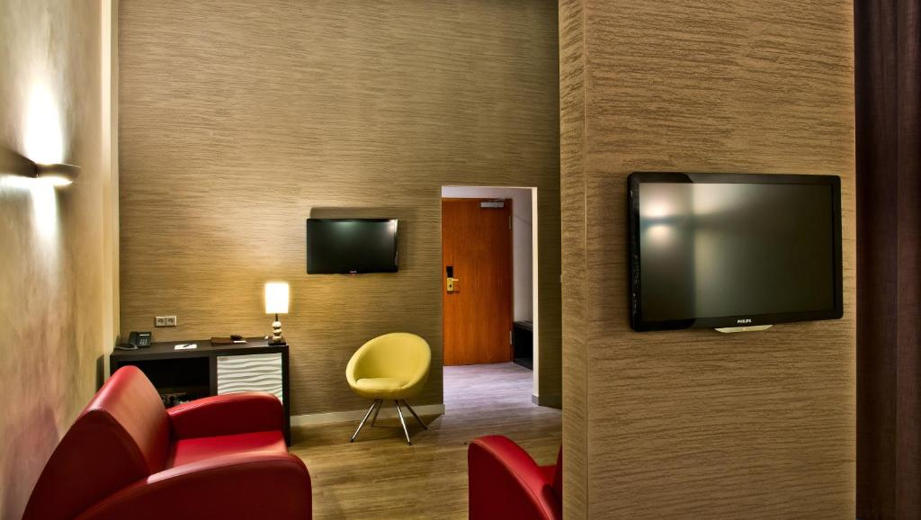 A television and/or entertainment center at Artim Hotel