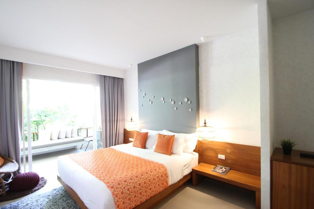 A bed or beds in a room at Bliss Resort Krabi
