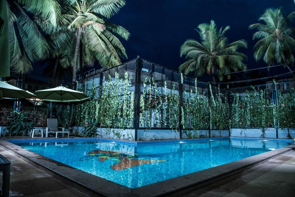 The swimming pool at or close to FabHotel Prime Sarala Crown Calangute Beach